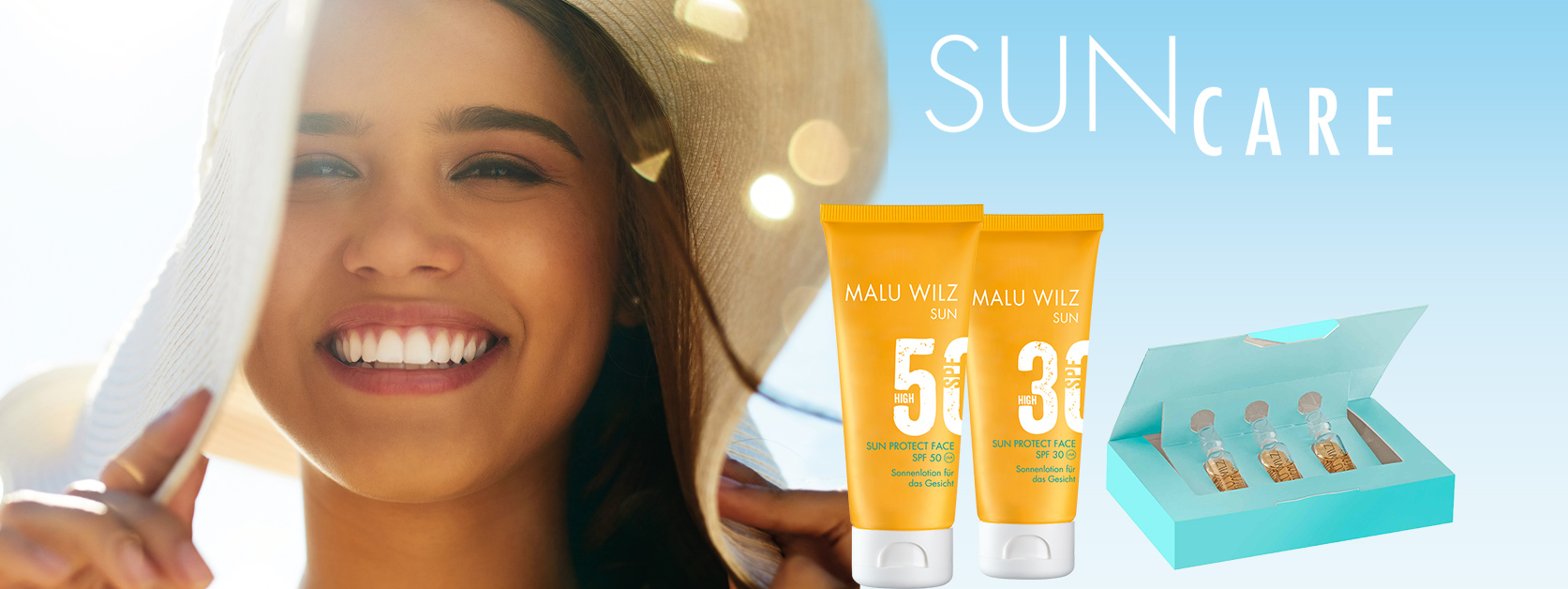 young woman with sun hat and sun care