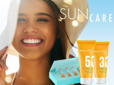 junge Frau mit Sun Care Produkten