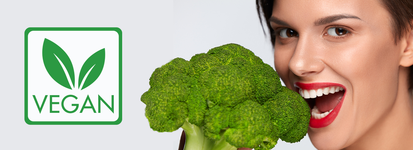 Portrait of young woman with broccoli