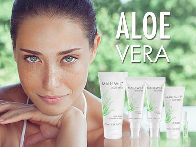 Junge Frau und Aloe Vera Produkte