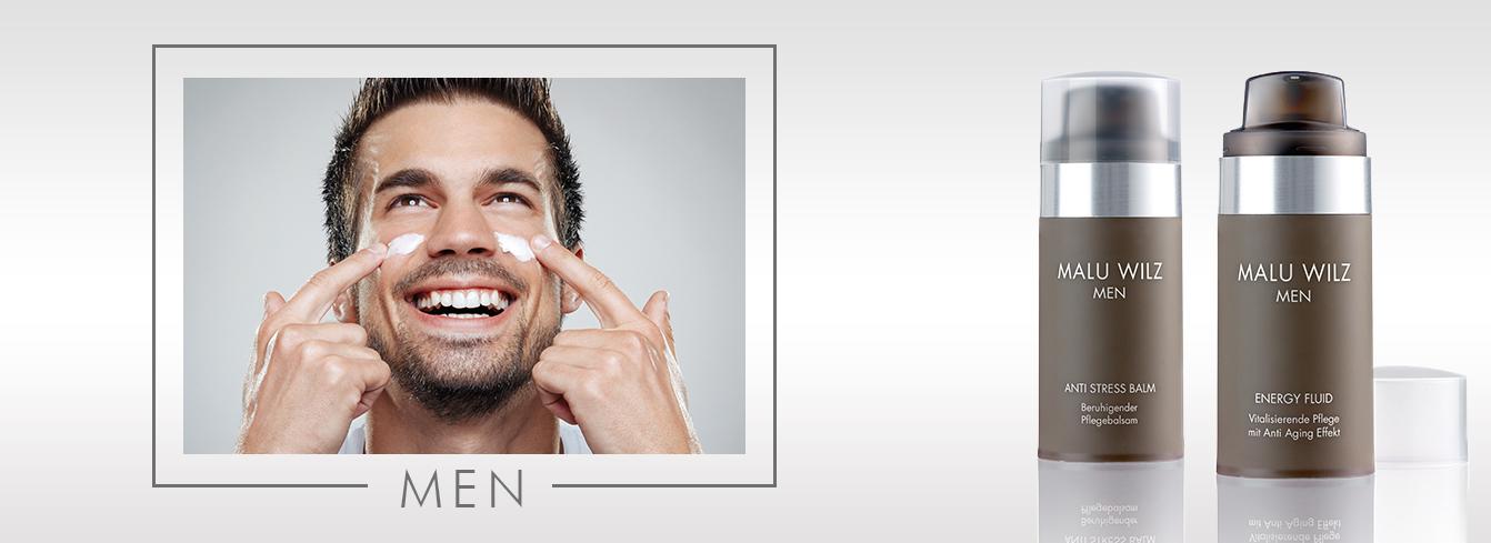 young man applies cream on his face