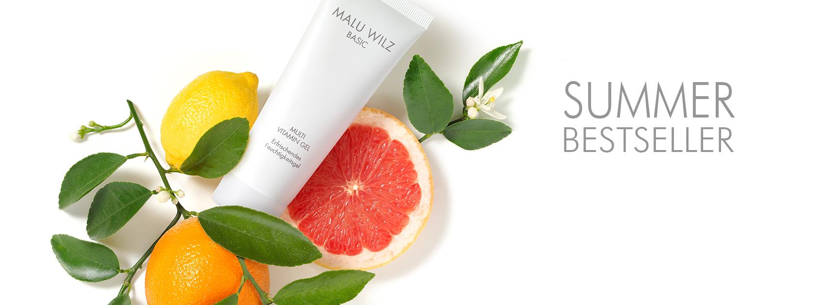 Zitrusfrüchte mit Hautpflege-Produkt